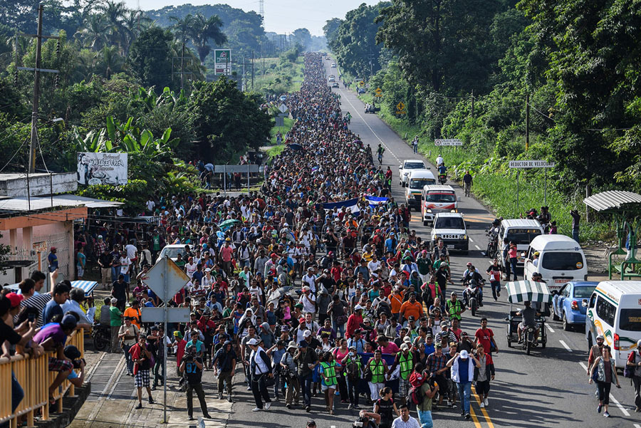 Honduran migrants take part in a caravan heading to the US, on the road linking Ciudad Hidalgo and Tapachula, Chiapas state, Mexico, on October 21, 2018. – Thousands of Honduran migrants resumed their march toward the United States on Sunday from the southern Mexican city of Ciudad Hidalgo, AFP journalists at the scene said. (Photo by Pedro Pardo / AFP) (Photo credit should read PEDRO PARDO/AFP/Getty Images)