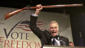 "performance at the NRA convention at which he publicly warned that nominee Al Gore would grab Heston's guns only ""from my cold, dead hands!"""