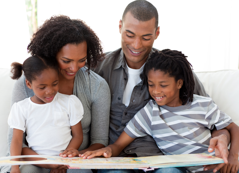 family reading together, father, mother, school aged children