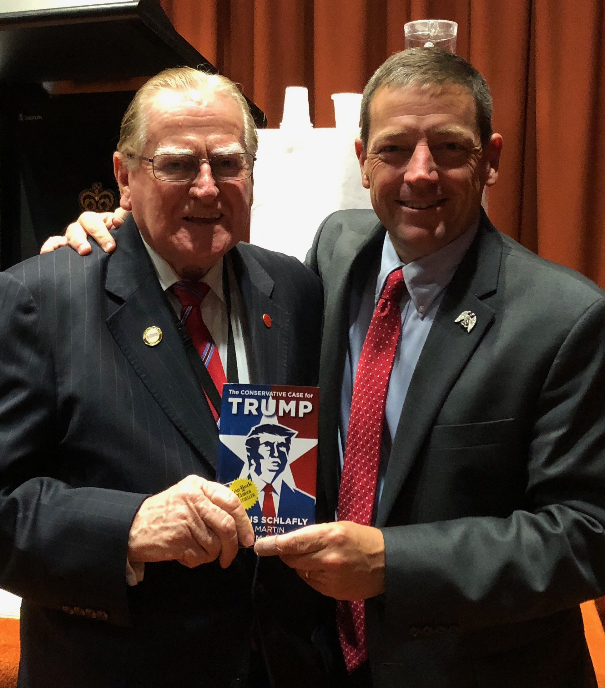 """Ed Martin presents """"The Conservative Case for Trump"""" book to Rev. Fred Nile 2017"""